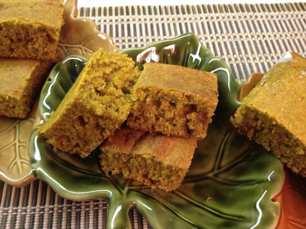 Six square slices of Pumpkin Cornbread in a festive fall leaf-shaped dish