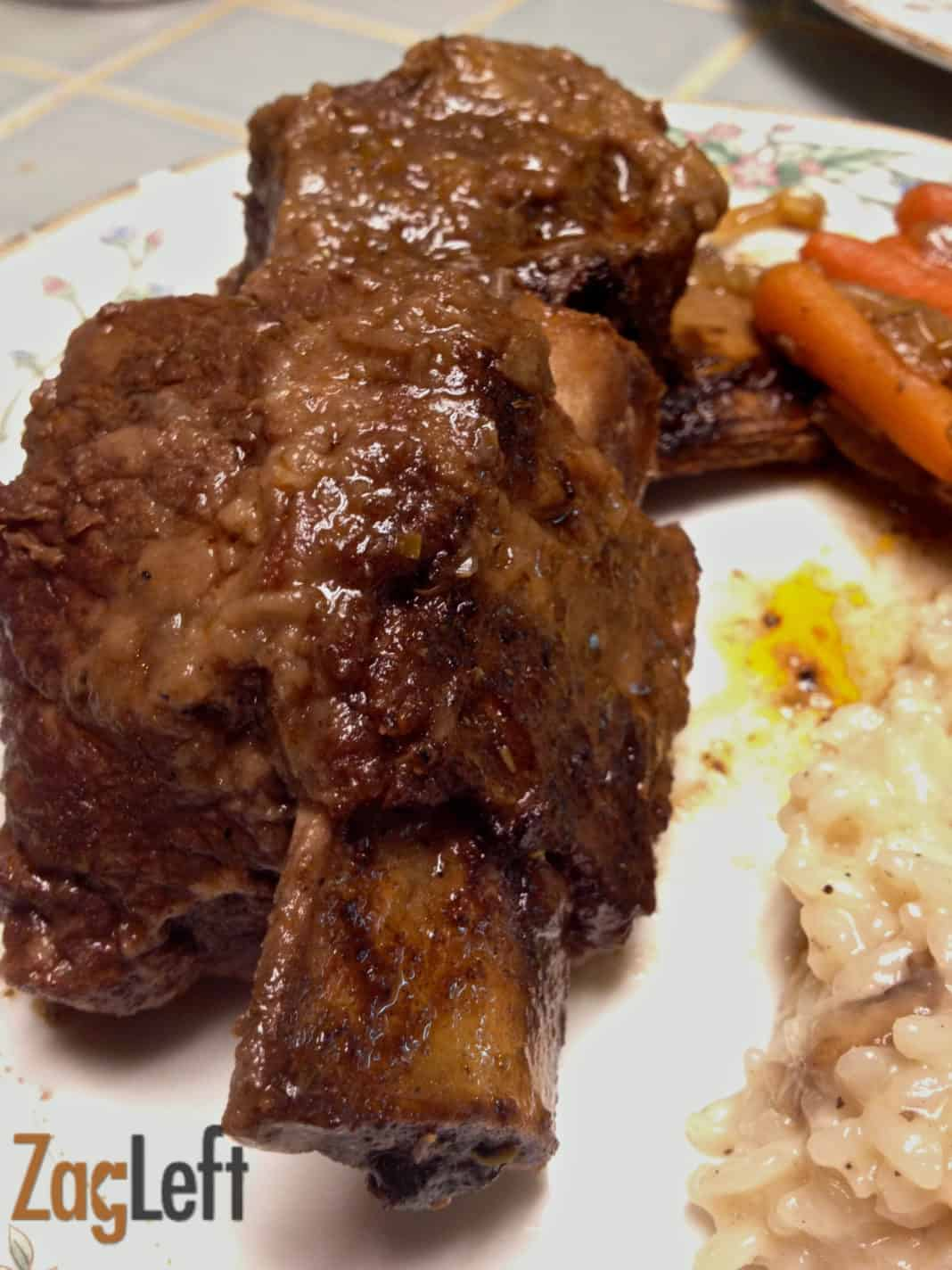 A plate of Braised Short Ribs With roasted Carrots  and a side of champagne risotto