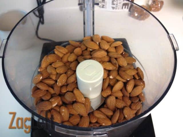 Raw almonds in a food processor