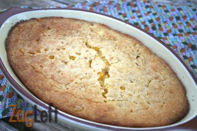 Cornbread Casserole in an oval-shaped serving dish