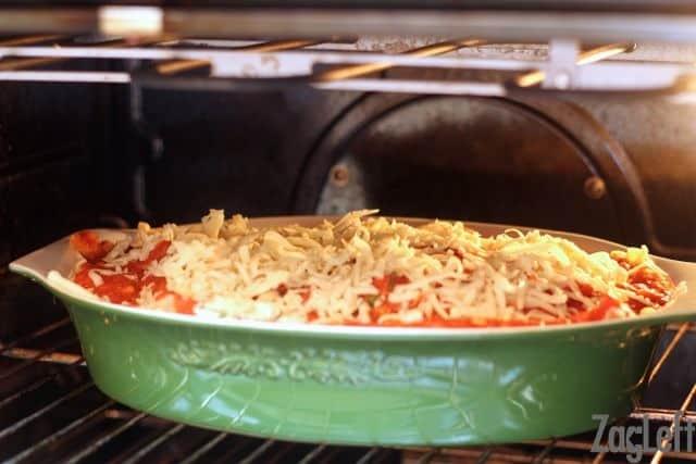 Pumpkin Lasagna in a baking dish baking in the oven