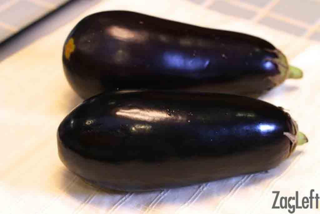 Two Eggplants on a cutting board