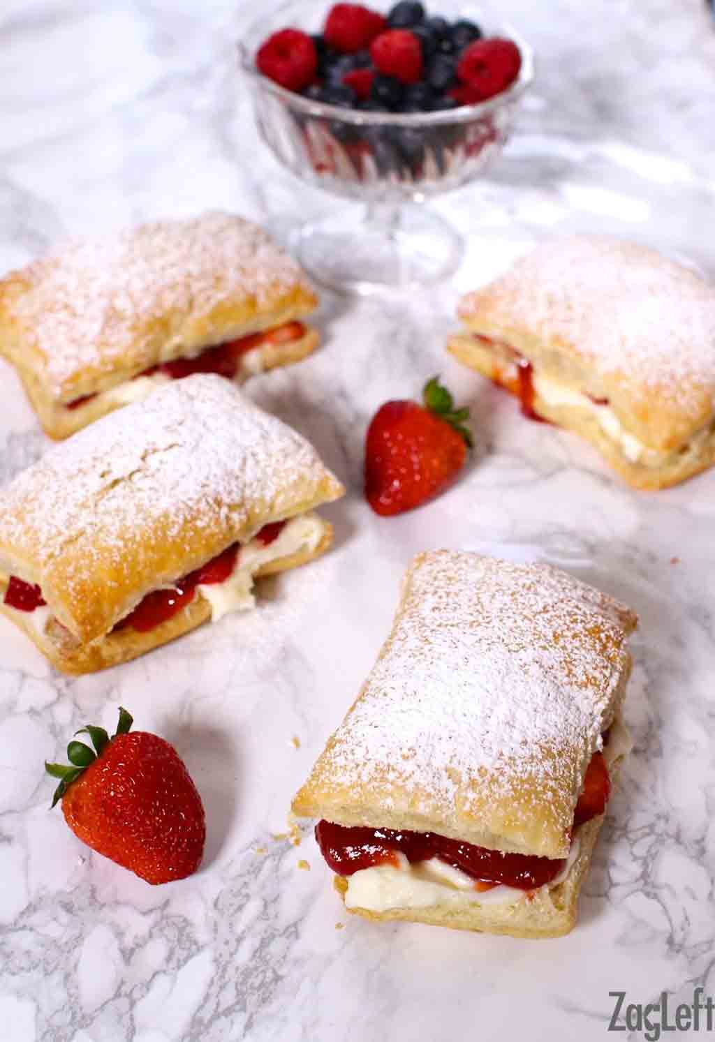 Light and flaky puff pastry, fresh strawberries, a creamy no-bake cheesecake filling, and a sweet strawberry sauce come together to make these quick and easy Strawberry Cheesecake Puffs...